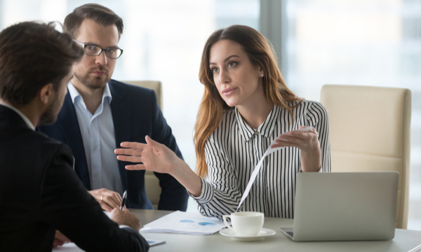 Disappointed woman talking to a coworker
