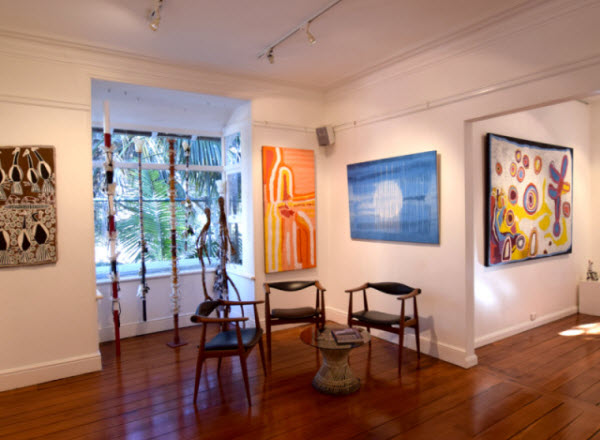 Chairs and paintings in an Art Gallery