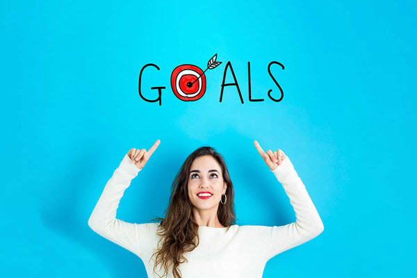 Woman pointing on a word GOALS
